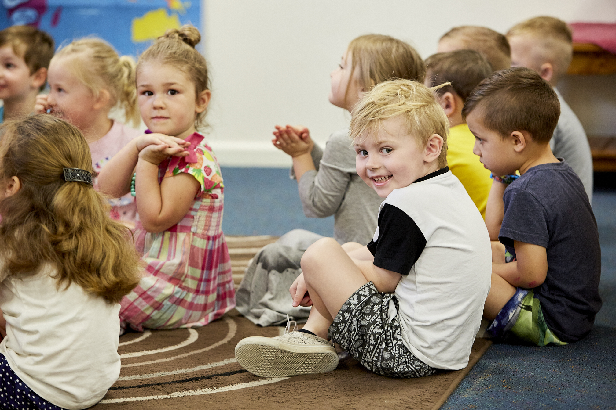 Group of children interacting in classroom setting